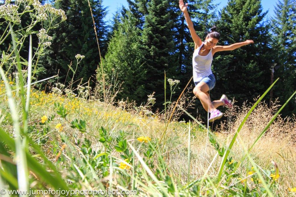 Self-portrait jumping photo by Eyoälha Baker http://www.jumpforjoyphotoproject.com