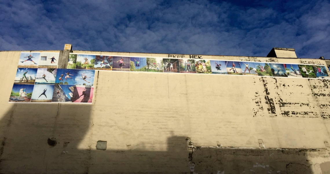 First day putting up posters for Wall of Joy corner of Abbott and West Pender St. Vancouver BC Canada