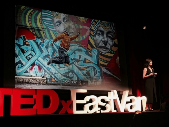 Eyoalha Baker, Founder of the Jump for Joy Photo Project on the TedXEastVan stage. April 23, 2016