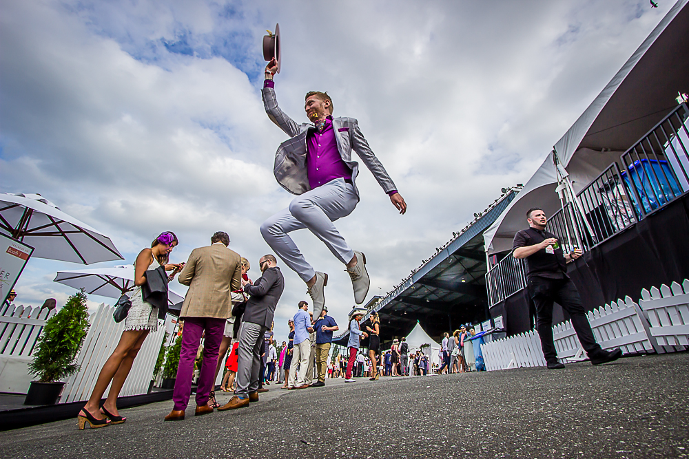 Jordan jumps for joy at the end of a fun day at the Vancouver Deighton Cup. Photo by Eyoalha Baker for the Jump for joy Photo project.