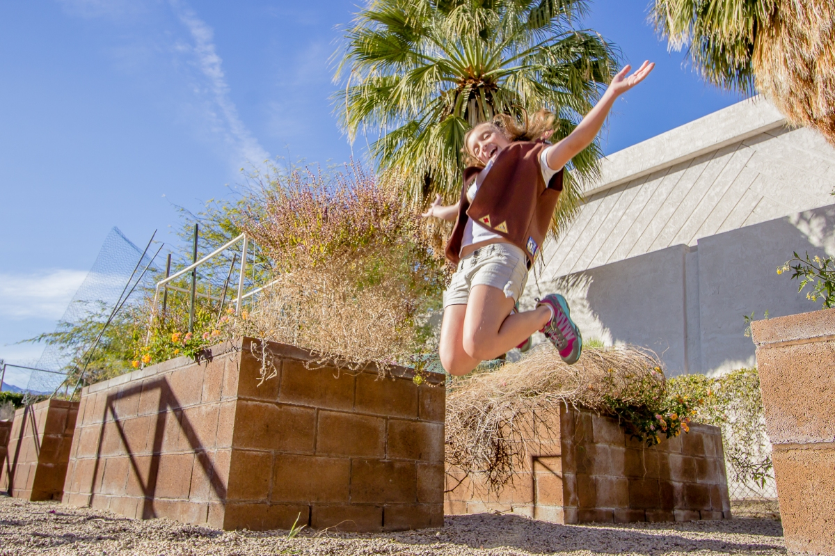 Anika Arnold jumping for joy in a vegetable garden – JUMP FOR JOY ...